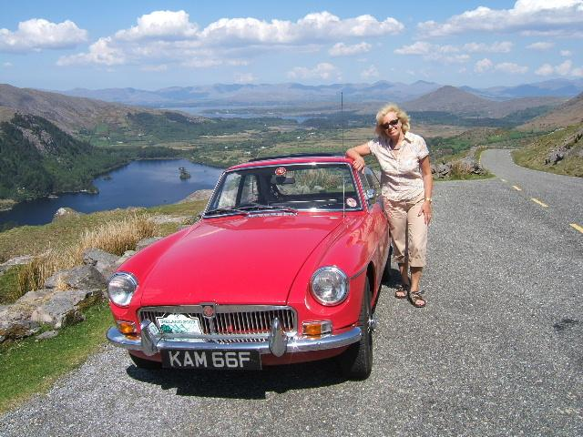 Waveney Burkitt with Jack Burkitt's 1967 MGBGT at the summit of the Healy pass near Killarney